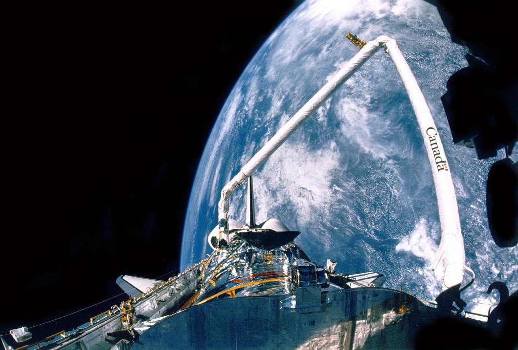 Canadarm being used to deploy the Hubble Space Telescope in 1990
