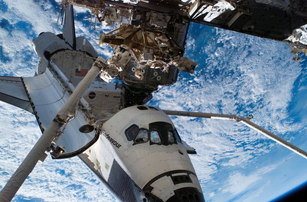 Canadarm and Canadarm2 in space