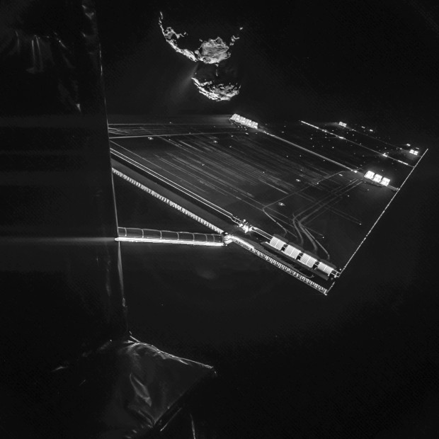 The Rosetta spacecraft captures a 'selfie' from 16 km above the surface of Comet 67P/Churyumov-Gerasimengo. Two images with different exposure times were combined to bring out the faint details in this very high contrast situation. The comet's active 'neck' region is clearly visible, with streams of dust and gas extending away from the surface. Rosetta's solar panel is visible in the foreground. The images were taken October 8 and released October 14, 2014. (CREDIT: ESA/Rosetta/Philae/CIVA)