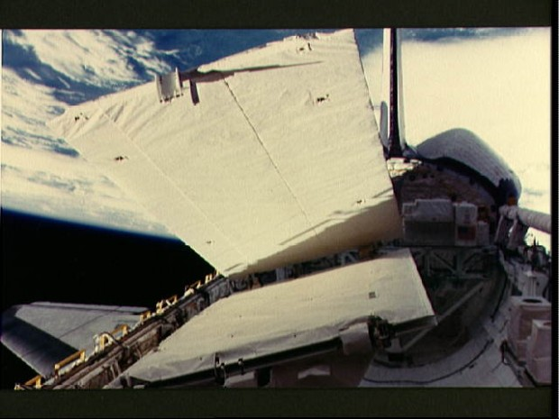 View of the SIR-B antenna being deployed during STS 41-G
