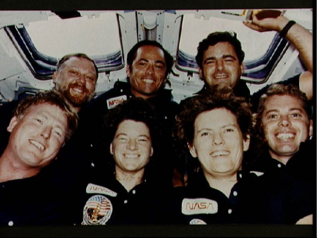 STS 41-G crew photo taken on the flight deck of the Challenger during the flight. Front row (l.-r.) Jon A. McBride, pilot; Sally K. RIde, Kathryn D. SUllivan and David C. Leestma, all mission specialists. Back row (l.-r.) Paul D. Scully-Power, payload specialist; Robert L. Crippen, crew commander; and Marc Garneau, payload specialist. Garneau represents the National Research Council of Canada and Scully-Power is a civilian oceanographer with the U.S. Navy.
