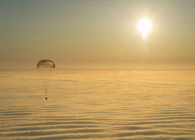 The Soyuz TMA-14M spacecraft is seen as it lands with Expedition 42 commander Barry Wilmore of NASA, Alexander Samokutyaev of the Russian Federal Space Agency (Roscosmos) and Elena Serova of Roscosmos near the town of Zhezkazgan, Kazakhstan on Thursday, March 12, 2015 (NASA/Bill Ingalls)