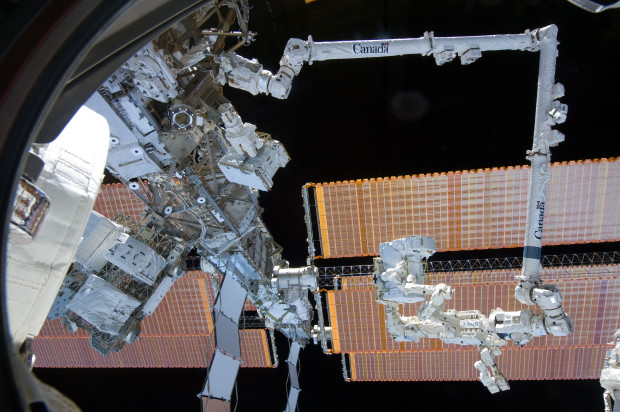 Canadian space robots: DEXTRE catches a ride at the end of Canadarm2 on the ISS. (Credit: NASA)