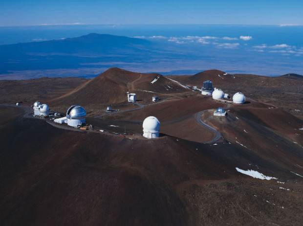 The observatories atop Mauna Kea, Hawaii include, from left to right foreground:  the UH 0.6-meter telescope (small white dome), the UK Infrared Telescope, the UH 2.2-meter telescope, the Gemini Northern 8-meter telescope (silver, open) and the Canada-France-Hawaii Telescope. On the right in the background are the NASA Infrared Telescope Facility (silver), the twin domes of the Keck Observatory and the Subaru Telescope (Source: University of Hawaii).