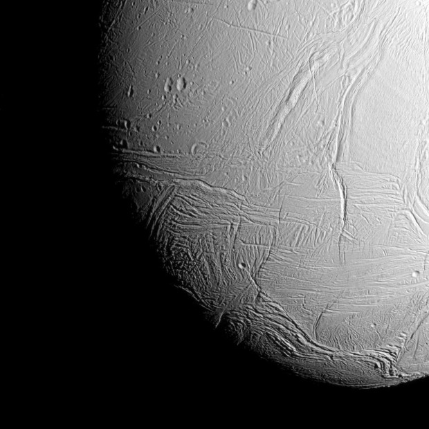 The south polar region of Saturn's active, icy moon Enceladus awaits NASA's Cassini spacecraft in this view, acquired on approach to the mission's deepest-ever dive through the moon's plume of icy spray. The wavy boundary of the moon's south polar region is visible at bottom, where it disappears into wintry darkness. CREDIT: NASA/JPL-Caltech/Space Science Institute